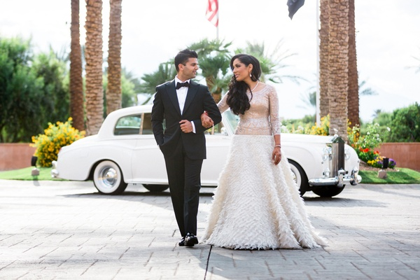 couple walking arm in arm classic tuxedo changes white dress rolls royce wedding california