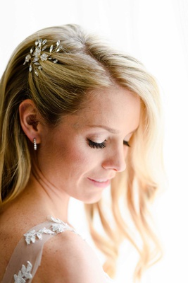 bride with blonde hair pulled away from face with bhldn headpiece long blonde curled hair