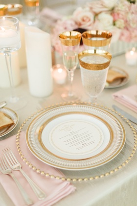 Wedding reception gold charger plate gold china circle menu card gold glassware ice water