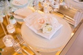 mirror top reception place setting white charger reflective flowers menu candles