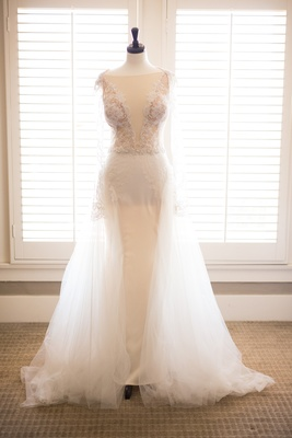 sheath gown overskirt plunging neckline galia lahav designer wedding revealing slits sleeves