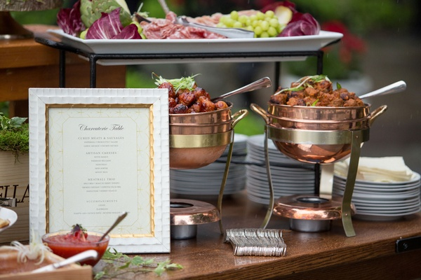 Wood table and sign with Charcuterie Table choices meat cheese sausage meatball garnish