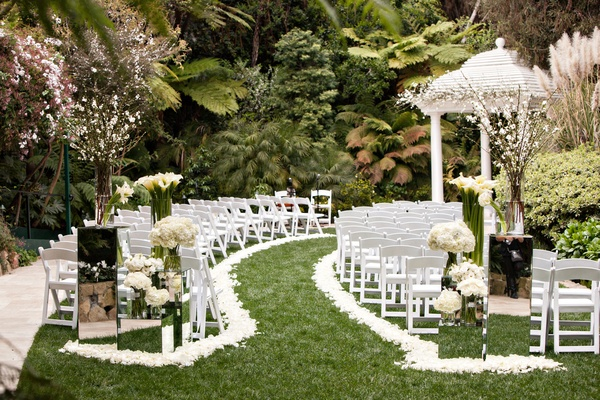 Elegant all white wedding with modern details at luxe bel air hotel bel air wedding ceremony white flower petal aisle mirror stands white gazebo junglespirit Choice Image
