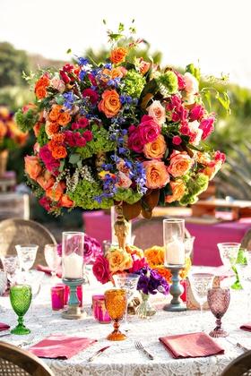 wedding reception lace linen cane chair green orange purple goblets orange pink green flowers