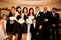 Bride and groom with bridesmaids, groomsmen, and flower girl