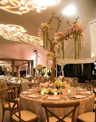 Round reception table with lace tablecloth and manzanita branch centerpiece