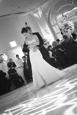 Black and white image of bride and groom's first dance