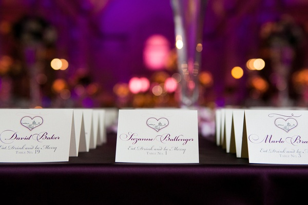 Seating cards with purple lettering and heart