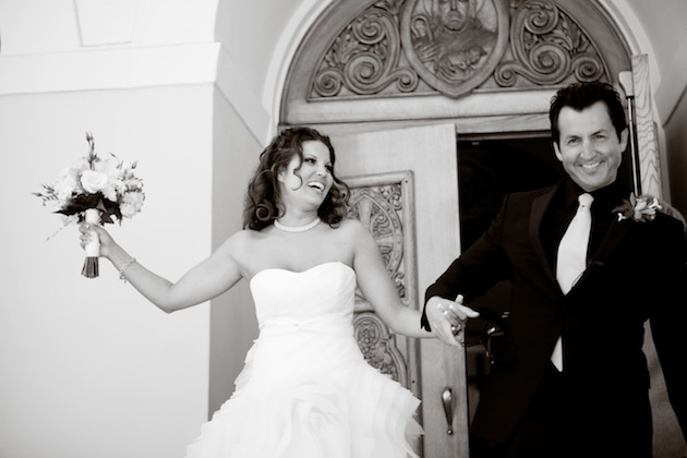 Black and white photo of couple leaving church ceremony
