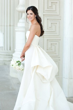 This stunning, classic wedding gown with a modern shape is worn by DFW Events bride Taylor.
