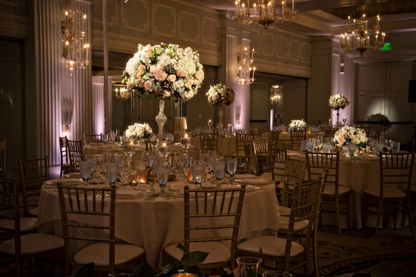 Pink purple uplighting ballroom Casa Del Mar hotel Santa Monica wedding tall flower arrangements