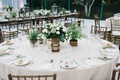 round tablescape green white details gold baskets centerpieces beach wedding reception oceanside ca
