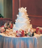 Wedding cake table with pink flowers