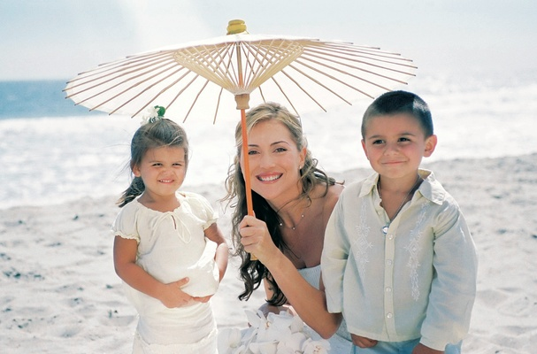 Bride with casual flower girl and ring bearer for beach wedding