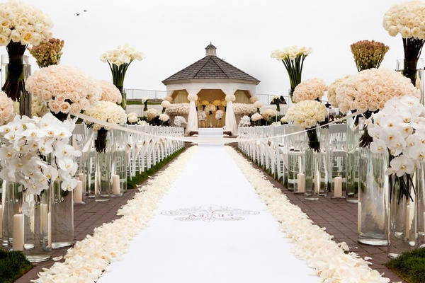 Oceanfront ceremony opulent pink and metallic reception for Wedding walkway