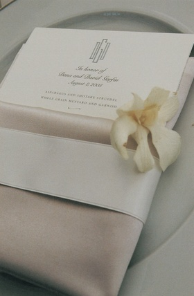 Menu card and napkin decorated with white flower