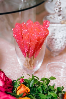 bridal shower dessert hot pink rock candy at sweets table white chocolates in apothecary jar flowers