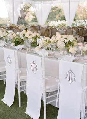 White linen chair covers with wedding monogram