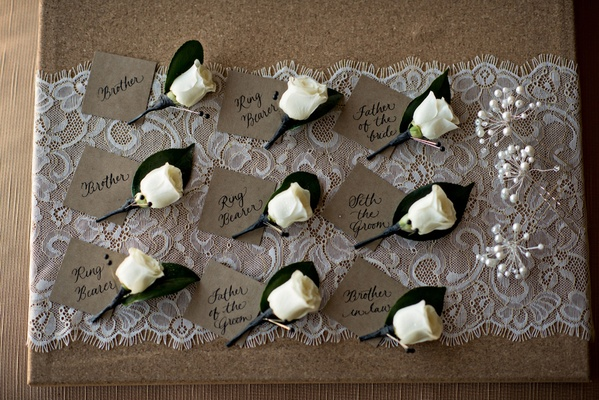 white rose wedding boutonnieres with name card