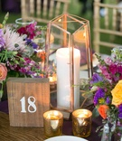 colorful berry tone floral centerpieces rustic wooden table number votives candles china
