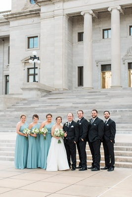bride in justin alexander plain ball gown, bridesmaids in turquoise after six dresses, groomsmen