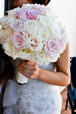 Pink and white roses in bouquet with rhinestones