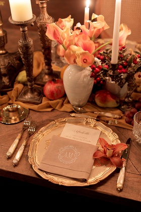 burlap colored napkin with embroidered monogram on ornate gold charger