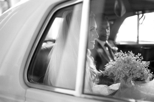 Black and white bride dress veil with lily of the valley bouquet white classic car father of bride