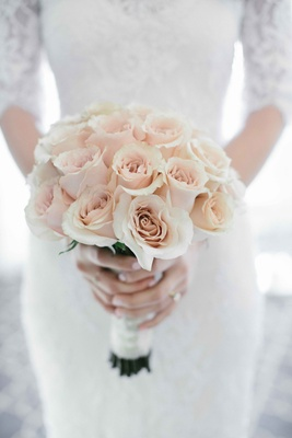 Wedding bouquet of single flower type light pink roses with white wrap