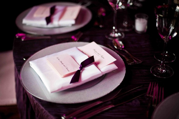 Silver plate with pink name card and purple ribbon and tablecloth