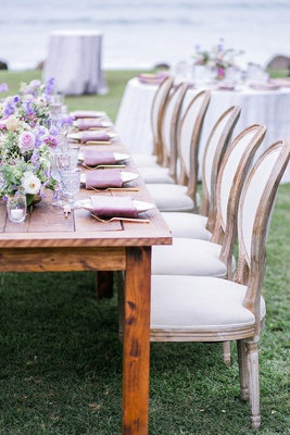 wedding reception destination wedding hawaii french upholstered chairs low purple flowers gold forks