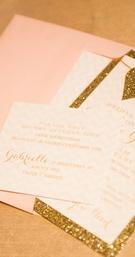 Wedding shower invitation with pastel pink envelope, golden glitter border, hearts, chevron design