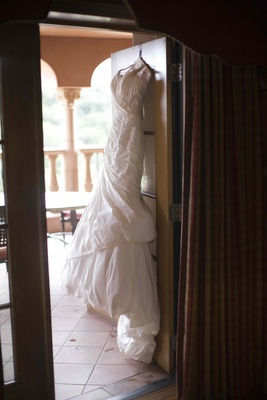 Ines Di Santo wedding dress on hanger