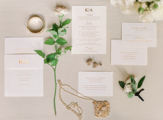 gold embossed invitation suite with modern monogram