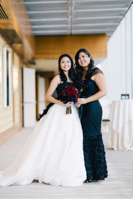 Black and white Vera Wang wedding dress and black JS bridesmaid dress