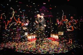 Gay wedding confetti pop as grooms kiss