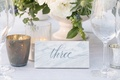 marble tile with grey calligraphy marking table numbers