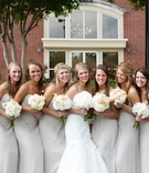 Long strapless bridesmaid dresses with ruching at the bust in an off-white color.