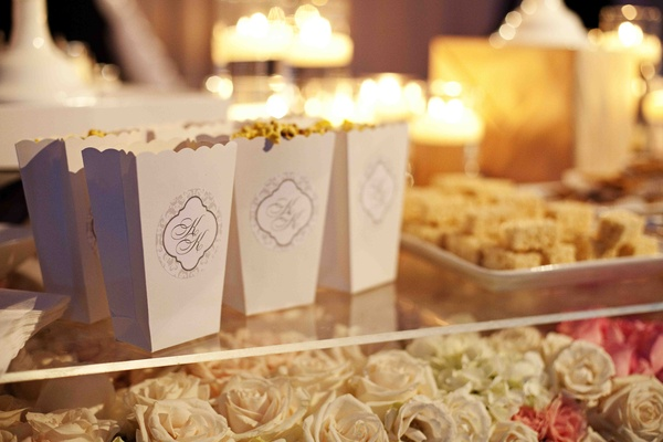 Scallop-edged popcorn containers on bed of roses