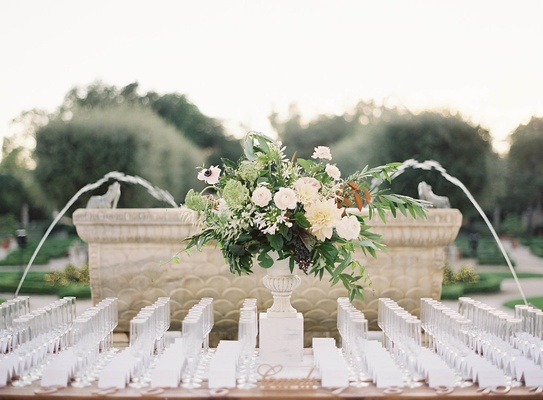 Outdoor wedding reception escort card table with laser cut details and champagne glasses neutral