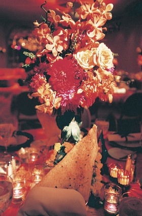 Papadum cracker under multi-colored centerpiece