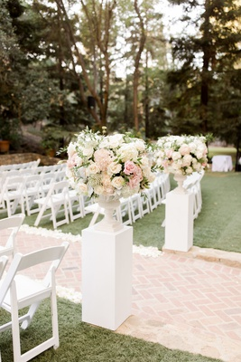 calamigos ranch wedding, white pillar with ivory florals, brick aisle
