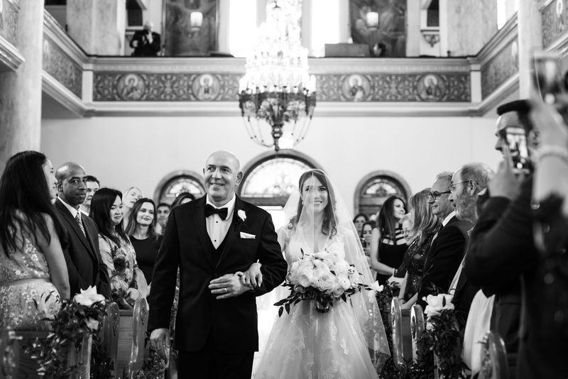 black and white photo of bride processional with father church greek orthodox cathedral