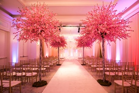 cherry blossom trees brought into indoor ceremony
