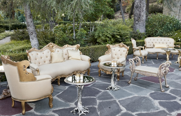 Treelike coffee tables and gold upholstered chairs