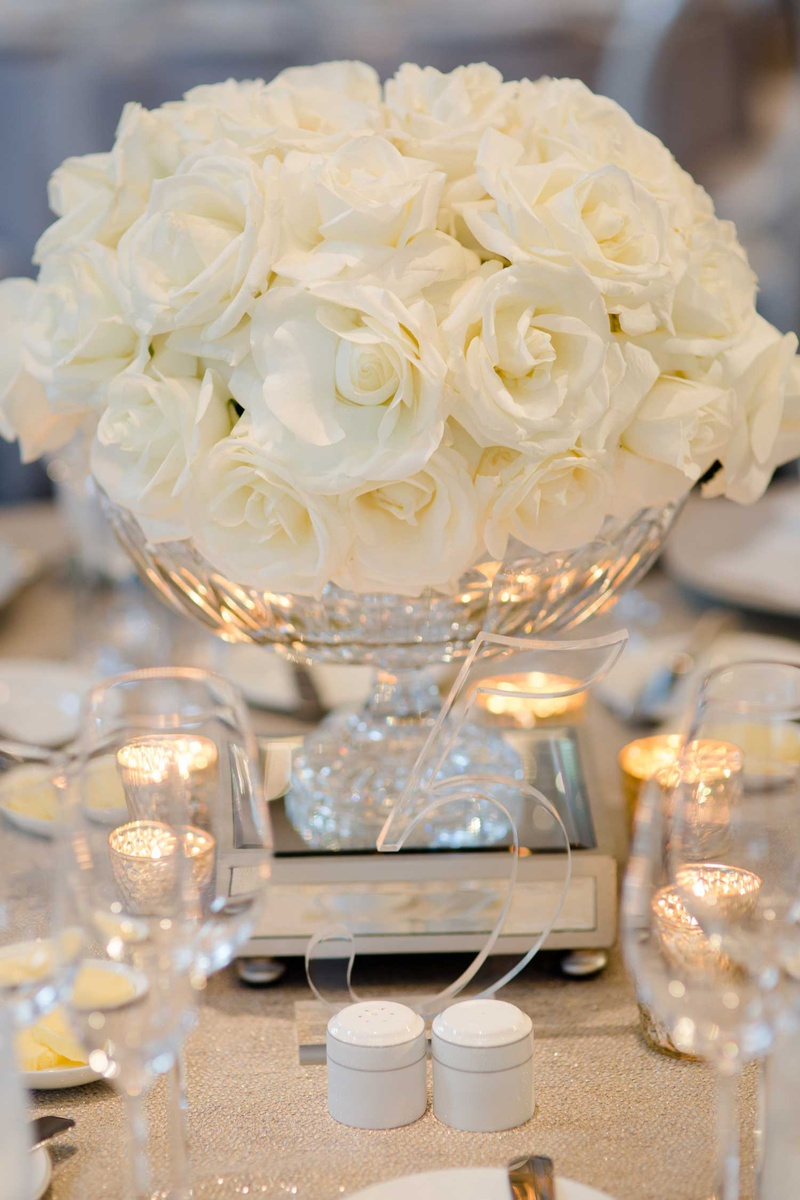 wedding reception centerpiece low arrangement white roses clear number five lucite