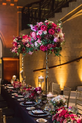 tall centerpiece on skinny gold stand, round arrangement of magenta florals