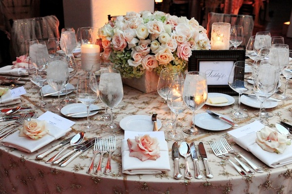 Elegant wedding table with rose and hydrangea centerpiece