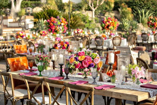wedding reception wood table vineyard chair orange head table pink yellow purple flowers