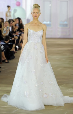 Sleeveless soft tulle ball gown with scooped neckline, sheer illusion bodice and hand painted overla